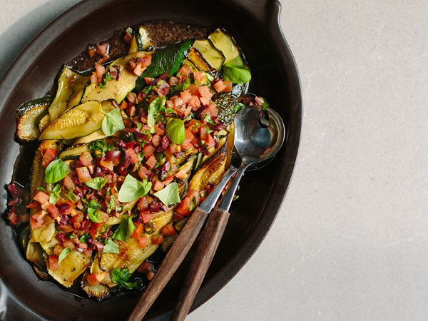 Grilled courgette with tomato, basil and black olive salsa