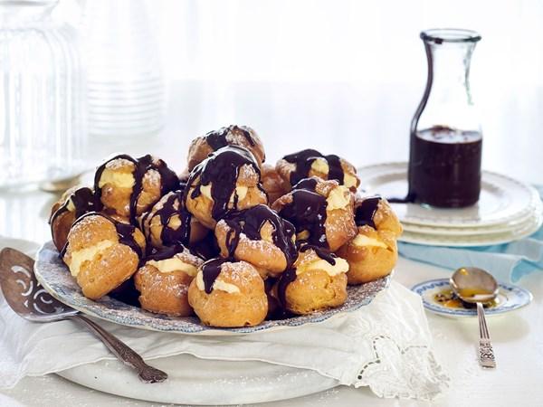 Profiteroles with passionfruit cream and chocolate fudge