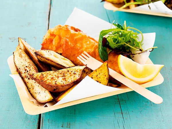 Cider-battered fish with spicy kumara wedges