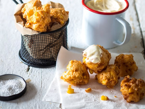 Cheese, corn and cayenne beignets with aioli