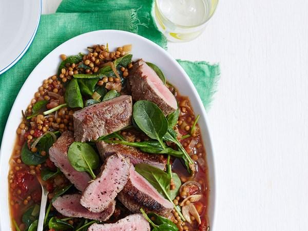 Roast lamb with braised lentils