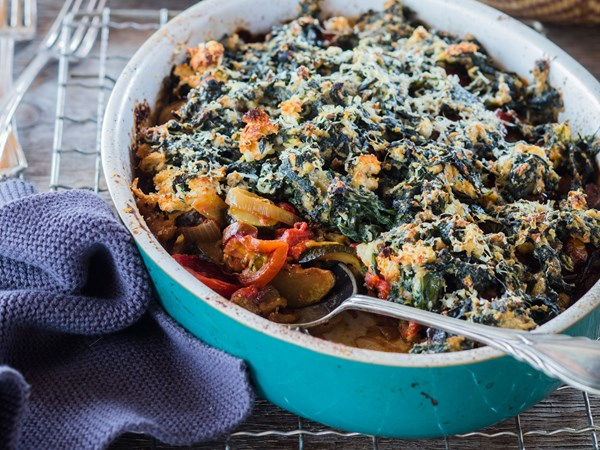 Summer vegetable bake with cheesy spinach topping