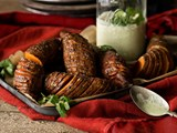 Hasselback kumara with green yoghurt sauce