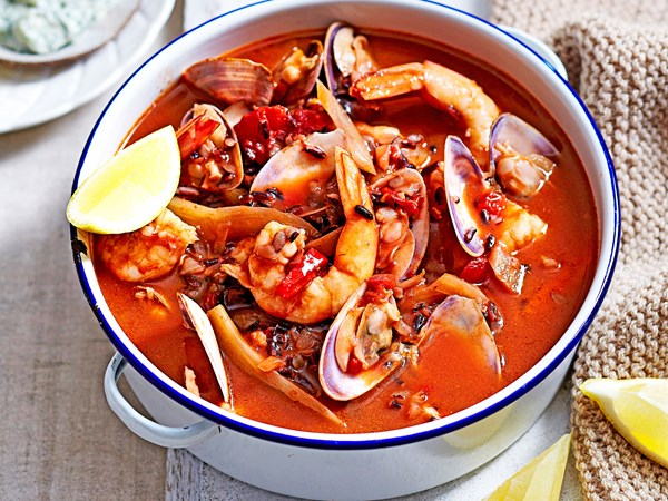 Spicy seafood soup with dill and caper mayo