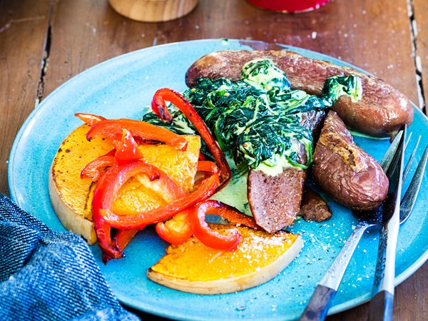 Baked sausages with creamed spinach