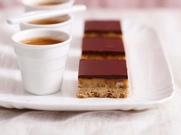 Dark chocolate nut slice with salted caramel filling