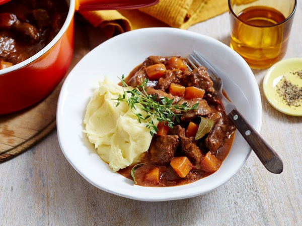 Beef and red wine casserole with mashed potatoes