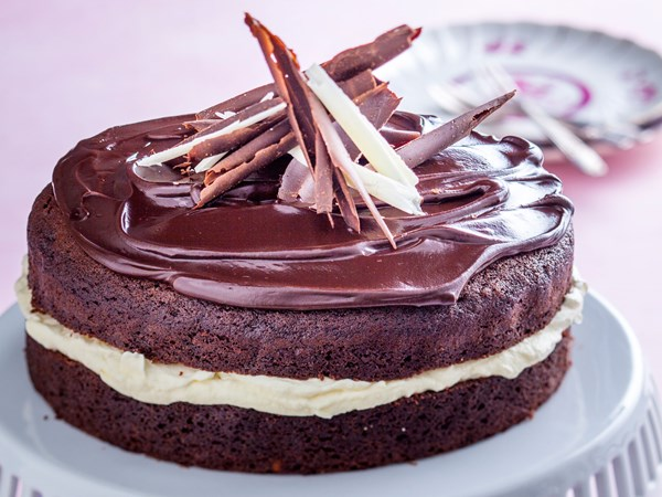 Chocolate cake with whipped cream, ganache and choc curls