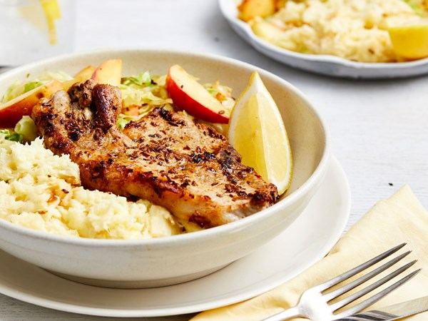 Pan-fried pork chops with apples, cabbage and parsnip mash