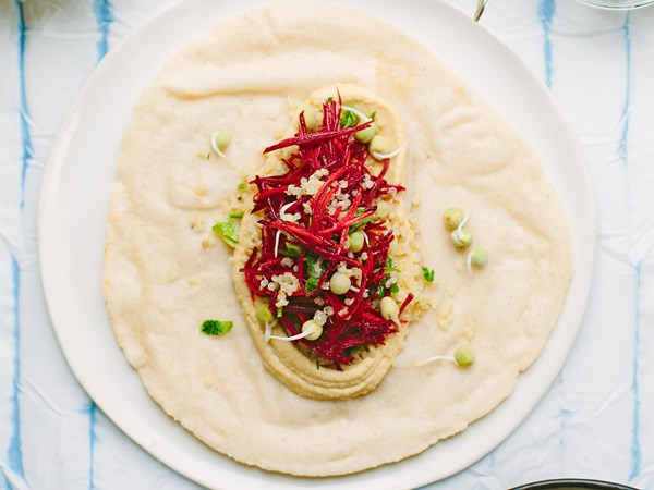 Vegetarian sprouted quinoa wraps with hummus