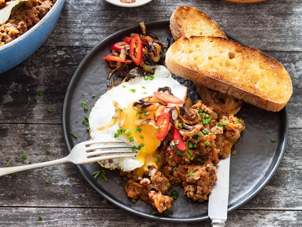 Fancy mince on toast with chilli, onions and egg