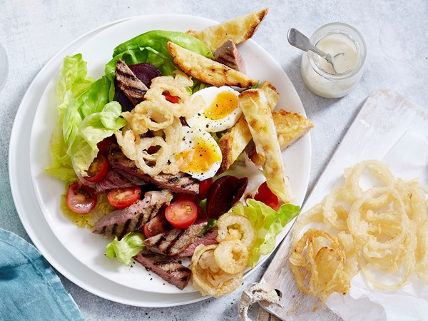 Beer battered onion ring steak salad