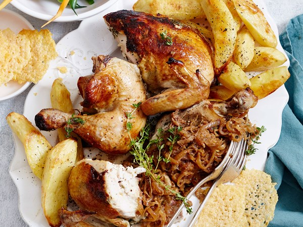 French onion-stuffed roast chicken with crispy potatoes