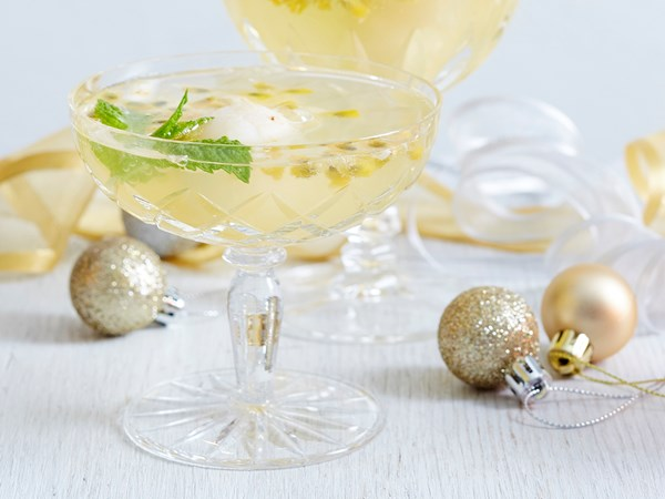 Lychee, mint and passionfruit champagne cocktail
