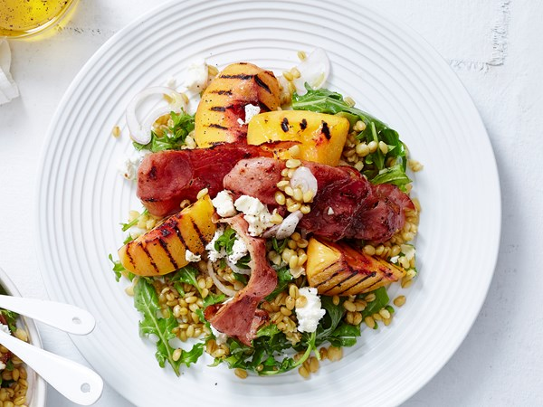 Grilled peach and farro salad with goat's cheese