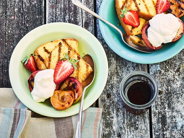 Grilled Madeira cake with brandy syrup and barbecued fruit