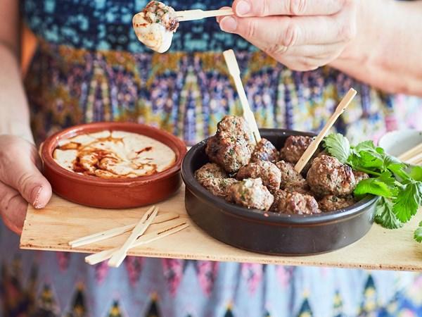 Lamb and coriander feta-stuffed meatballs with yoghurt sauce