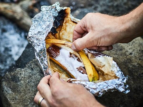 Gooey campfire baked chocolate and marshmallow bananas