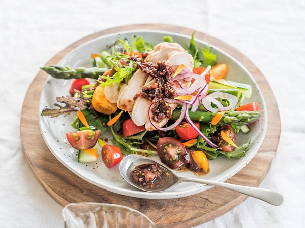 Smoked chicken summer salad with black olive dressing