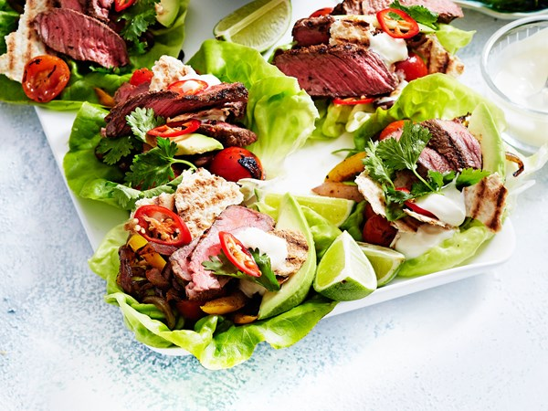 Naked fajita lettuce cups with beef, avocado and lime