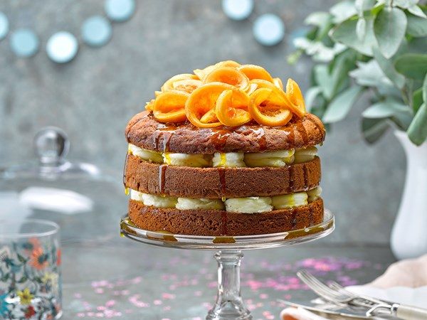Spiced kumara cake with orange syrup and frosting
