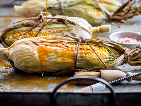 Buttery garlic barbecued corn with smoked paprika oil