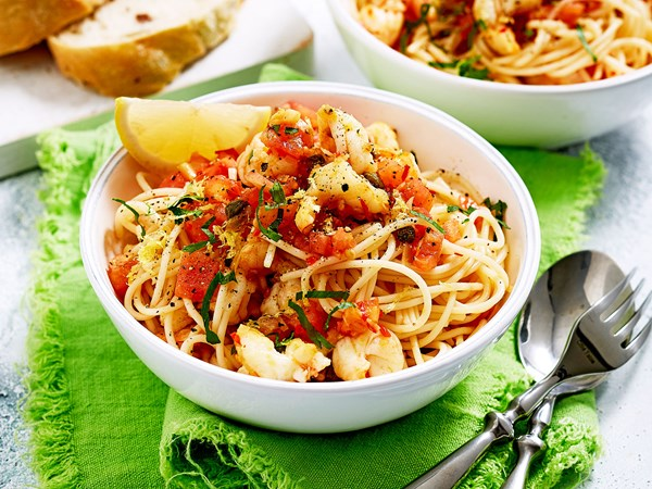 Prawn spaghetti pasta with chilli, capers and tomato