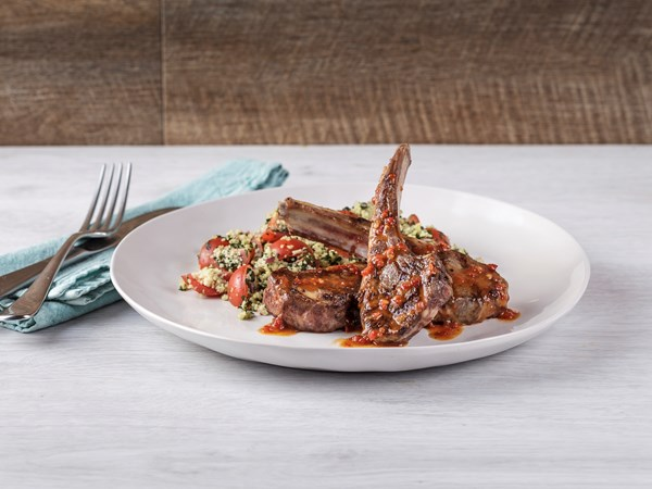 Lamb cutlets with harissa drizzle and tabbouleh