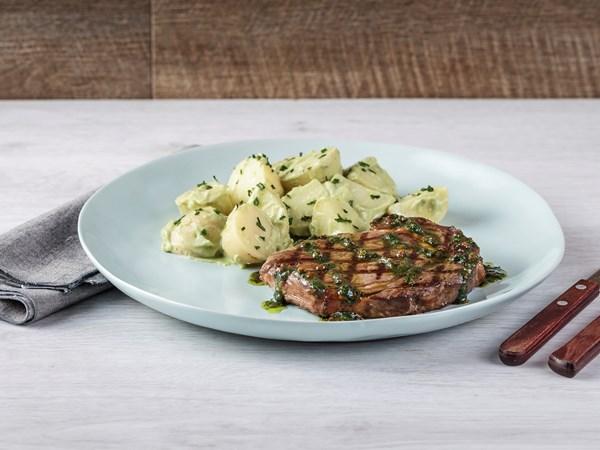 Steak with chimichurri drizzle and green potato salad