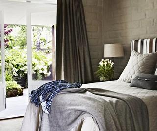 Beige bedroom with balcony