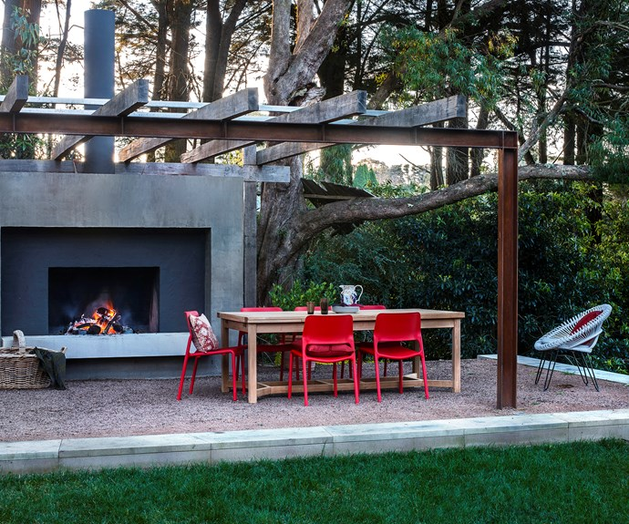 """Nestled beneath gum trees and boasting an impressive fireplace, this simple outdoor space in the NSW Southern Highlands, by [David Luckie Design](http://www.davidluckiedesign.com.au/?utm_campaign=supplier/