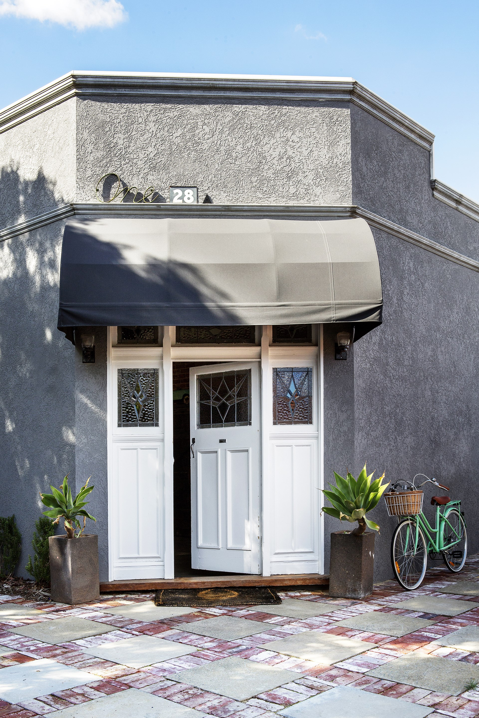 Despite its Art Deco corner shop appearance, Carla and Ben Karsakis's Perth home is only three years old. The exterior walls are made from rendered structural insulated panels; their high thermal mass helps the home stay comfortable year-round.
