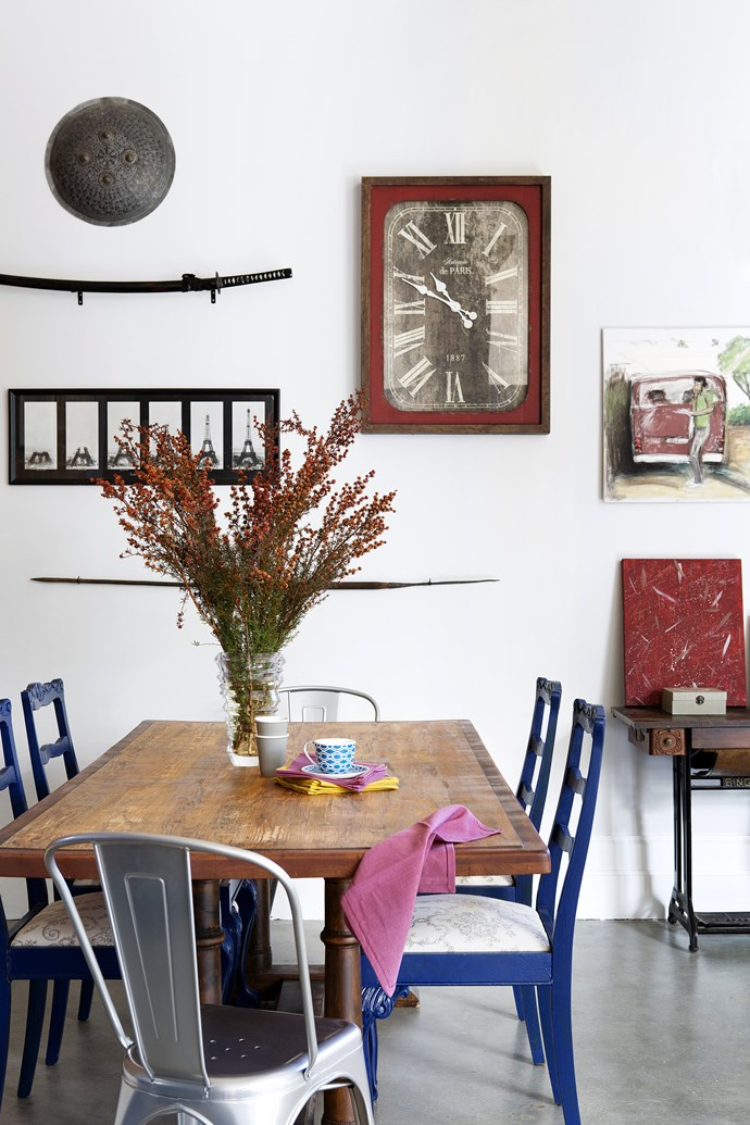 The dining table, formerly a refectory table, is teamed with revamped antique and replica Tolix chairs. Ben's grandmother's treadle sewing machine has been repurposed as a side table.