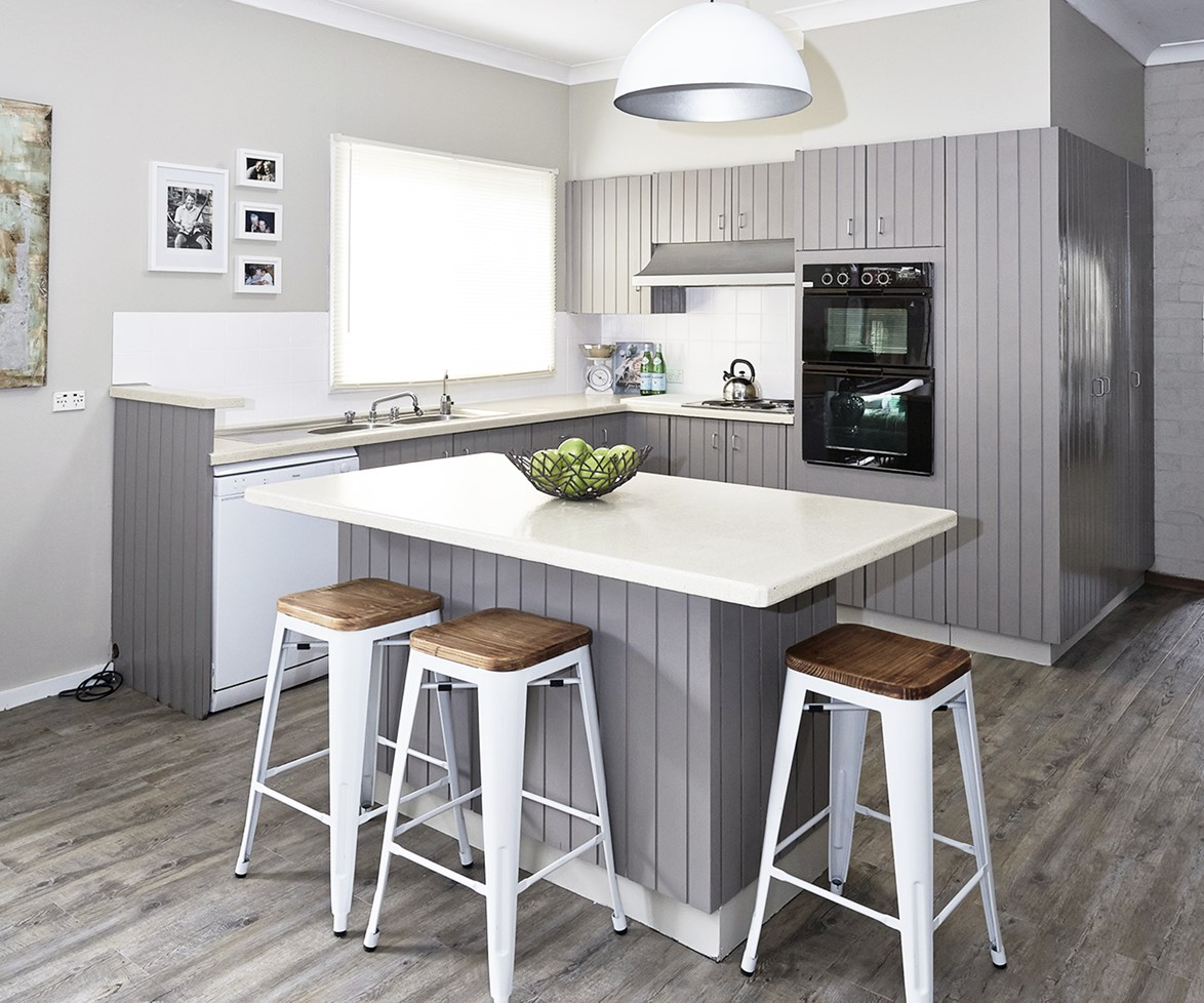 """Give your dated and daggy kitchen a fresh and contemporary new look with a [budget DIY renovation](http://www.homestolove.com.au/the-5-secrets-of-budget-kitchen-renovations-1776