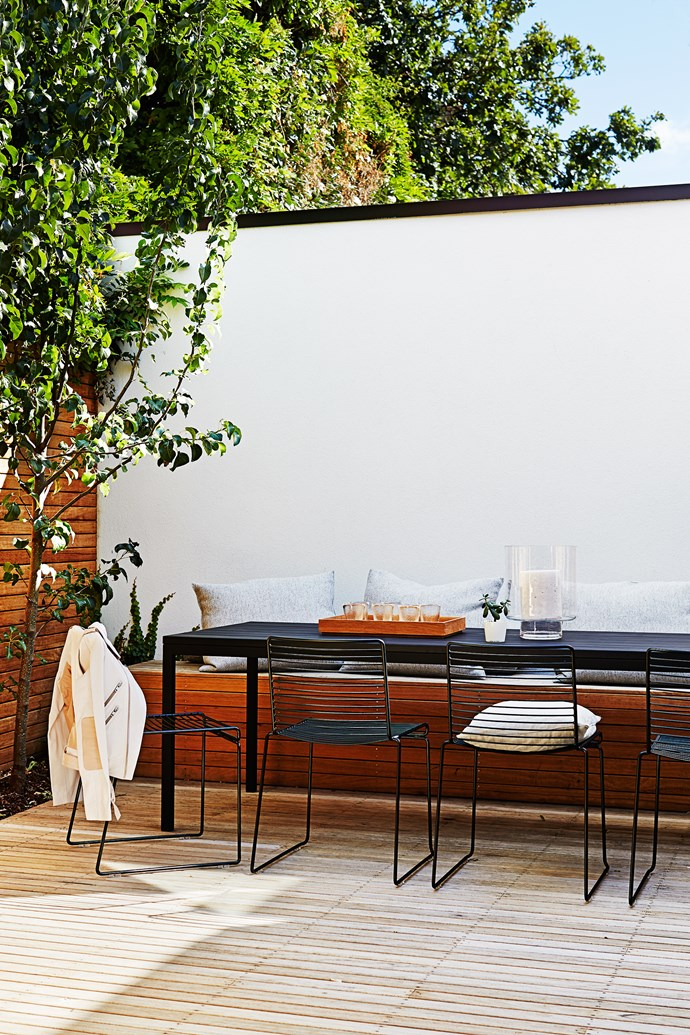 "A decent-sized outside table from [Tait](http://madebytait.com.au/|target=""_blank"") allows the family to eat and entertain easily outdoors. Hee chairs by Hay from [Cult](http://www.cultdesign.com.au/