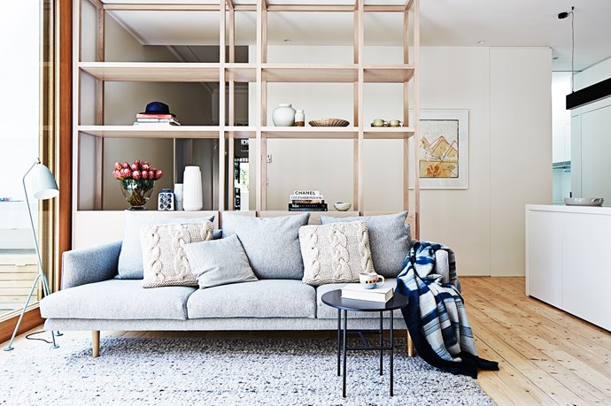 "The sofa is positioned to make the most of the northern light that floods the living space.   Nook **sofa** upholstered in Boucle Tin from Jardan. The **shelving** was custom-made, for similar, try Five Upright from [Like Butter](http://www.likebutter.com.au/|target=""_blank"").  Gubi Grasshopper **floor lamp** in Anthracite Grey and Cappellini **side table** from [Cult](http://www.cultdesign.com.au/