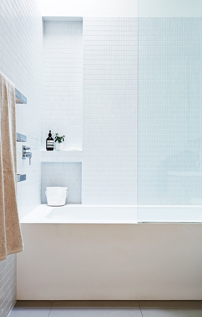 "The bathroom was a complete rebuild with a new built-in bath with combined shower and a clunky vanity removed.    Neve matt **wall tiles** (45mm x 95mm) from [Classic Ceramics](http://www.classicceramics.com.au/|target=""_blank"").  Mizu Soaker Rectangle 1700 **bath** from [Reece](http://www.reece.com.au/