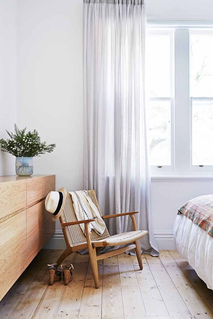 "Allowing the sheer-linen curtains from [Unique Fabrics](http://www.uniquefabrics.com/|target=""_blank"") to pool on the floor adds a luxurious touch to the bedroom."
