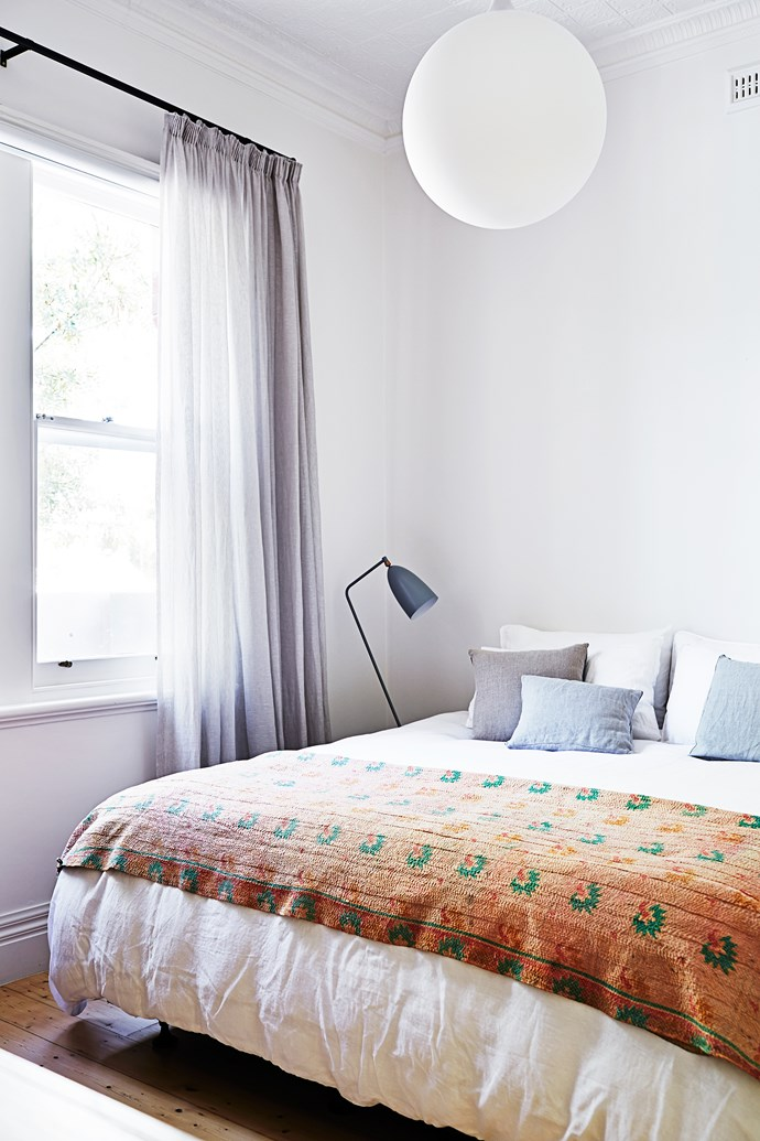"The sheer-linen curtains from [Unique Fabrics](http://www.uniquefabrics.com/|target=""_blank"") give a calm feeling to the master bedroom, while the Gubi Grasshopper lamp from [Cult](http://www.cultdesign.com.au/