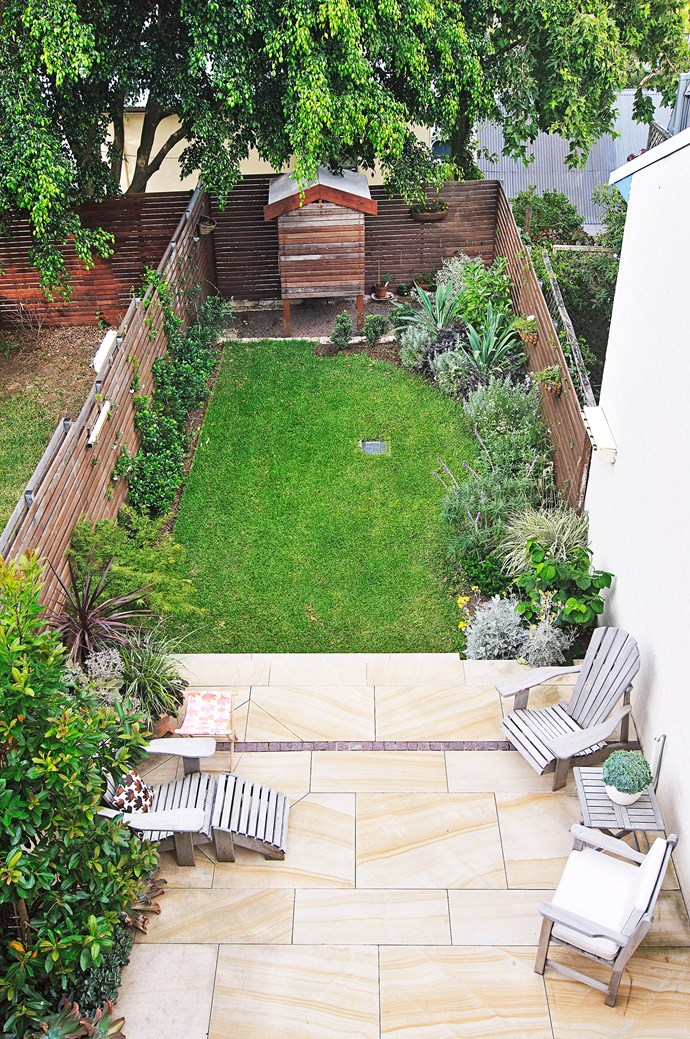 Large, light-coloured pavers help to widen this narrow backyard. Photo: Robert Reichenfeld / bauersyndication.com.au