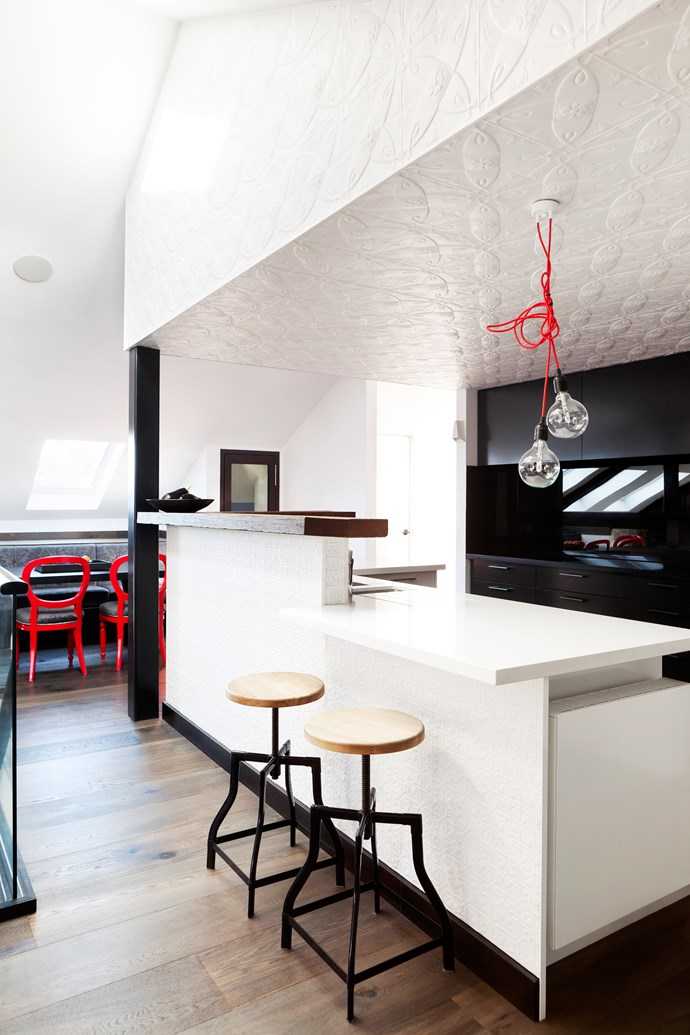 """""""I wanted to make sure we capitalised on the original features like the timber beams and brick walls so we left the colours clean and simple, using a repetition of white and charcoal throughout then bringing in pops of colour,"""" says Camilla.   **Walls** throughout painted in [Dulux](http://www.dulux.com.au/ target=""""_blank"""") Lexicon and Domino. **Stools** from [Globe West](http://www.globewest.com.au/ target=""""_blank""""). **Benchtops** from [Caesarstone](http://www.caesarstone.com.au/ target=""""_blank"""")."""