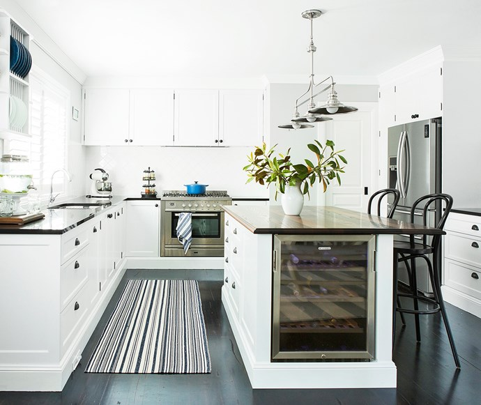 Hamptons-style white kitchen with wine fridge