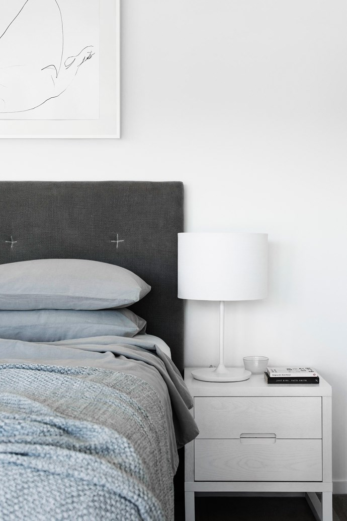 """Monochrome artworks are subtle in nature so as to not intrude on the delicate palette, such as the *Dance of the In-Between* print by [Craig Ruddy](http://www.craigruddy.com/?utm_campaign=supplier/ target=""""_blank"""") above the bed in the main bedroom."""