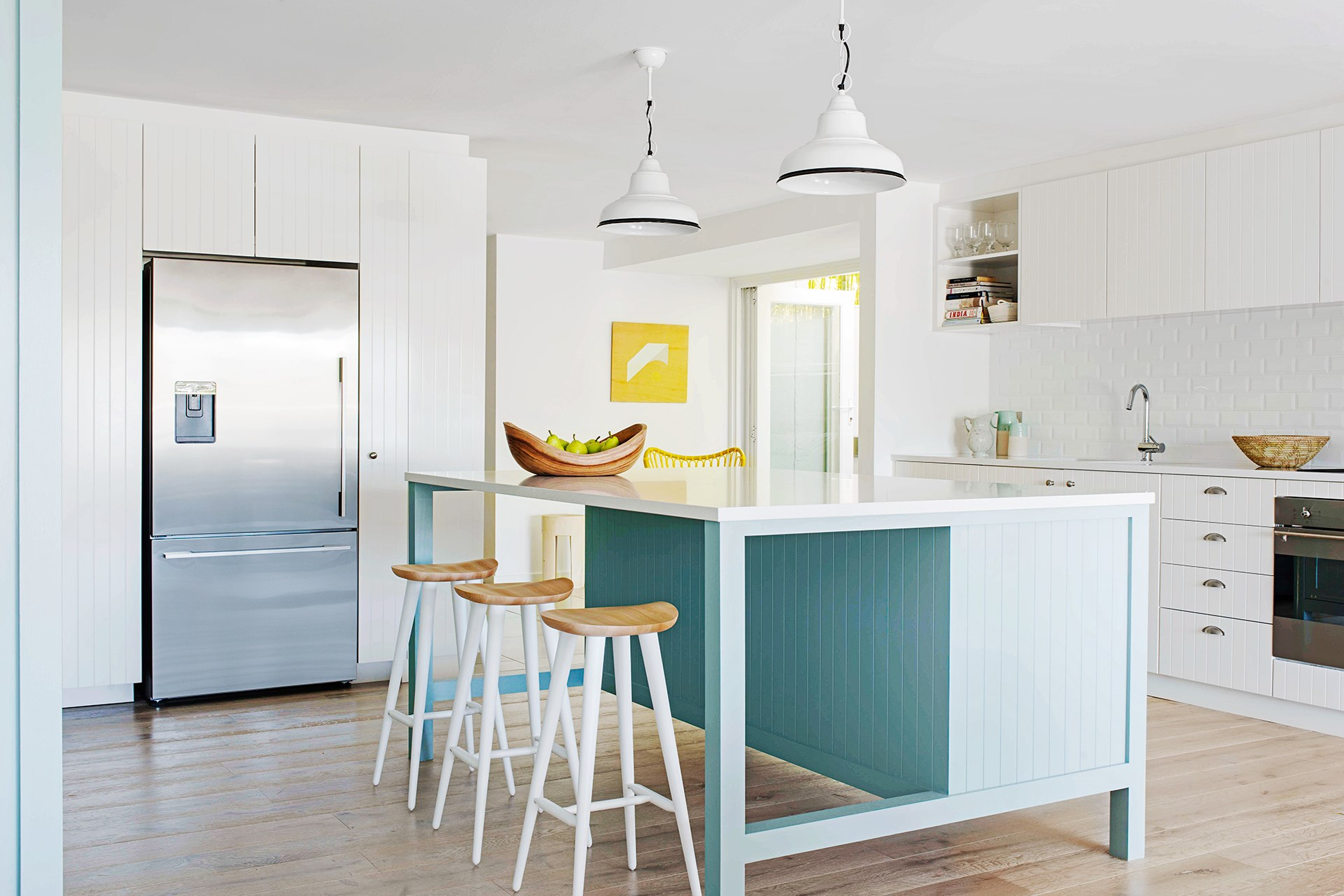 """A dusty shade of blue with a splash of yellow is a modern take on a classic beachy colour combo that perfectly suits this [Sydney beach house](http://www.homestolove.com.au/textured-modern-beach-house-in-sydney-2090