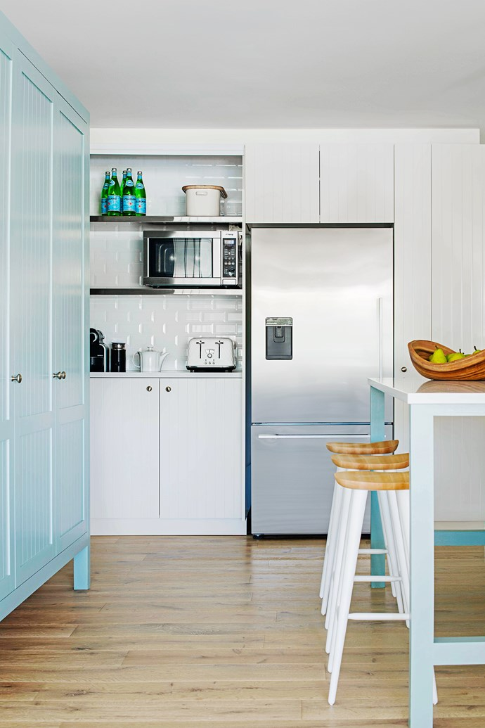 Andrew designed an appliance cupboard with bifold doors that allows this busy area to be easily closed off when the family is entertaining, an important consideration when the kitchen is open to social areas.