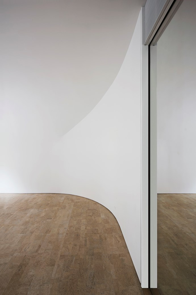 """**CRS Studio** To blur the edges and confuse the perception of space the architects designed curved walls by molding dampened plasterboard. Photo: [GION](http://gionstudio.com/?utm_campaign=supplier/