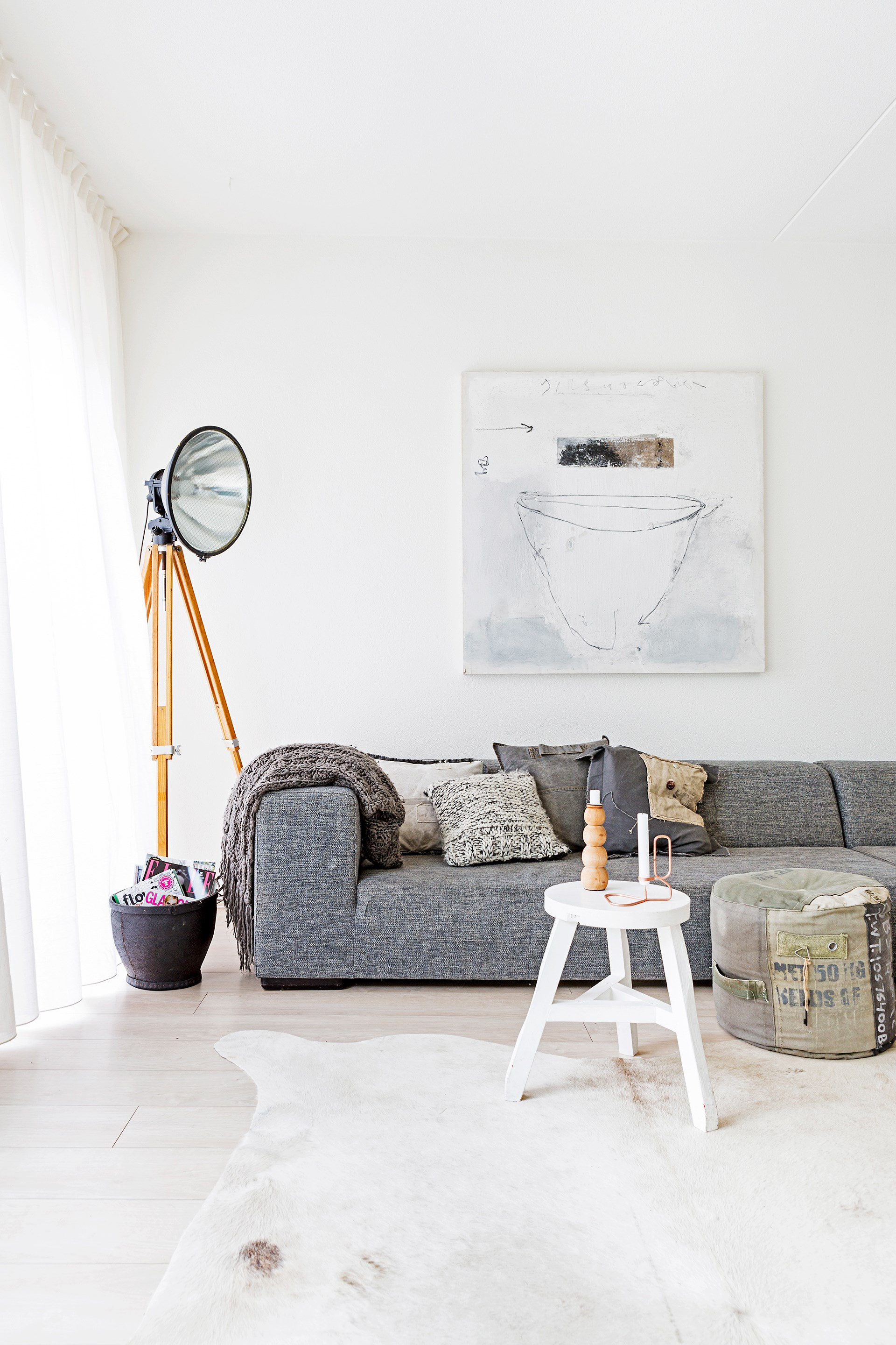 """The living area with a lowline sofa from [Sur&Plus](http://www.sur-plus.be/en/?utm_campaign=supplier/ target=""""_blank"""") is the family's """"ultimate"""" chill-out zone. An old airport floodlight was made into a floor lamp."""
