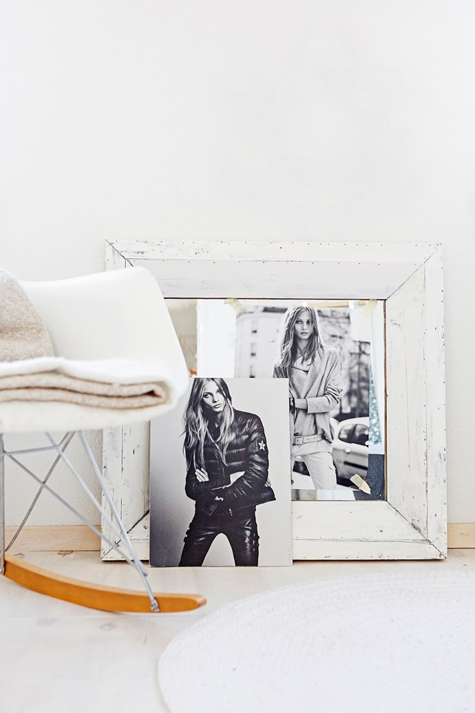 An Eames DSW Rocker chair and a couple of edgy black-and-white fashion pics decorate an empty corner in the master bedroom.