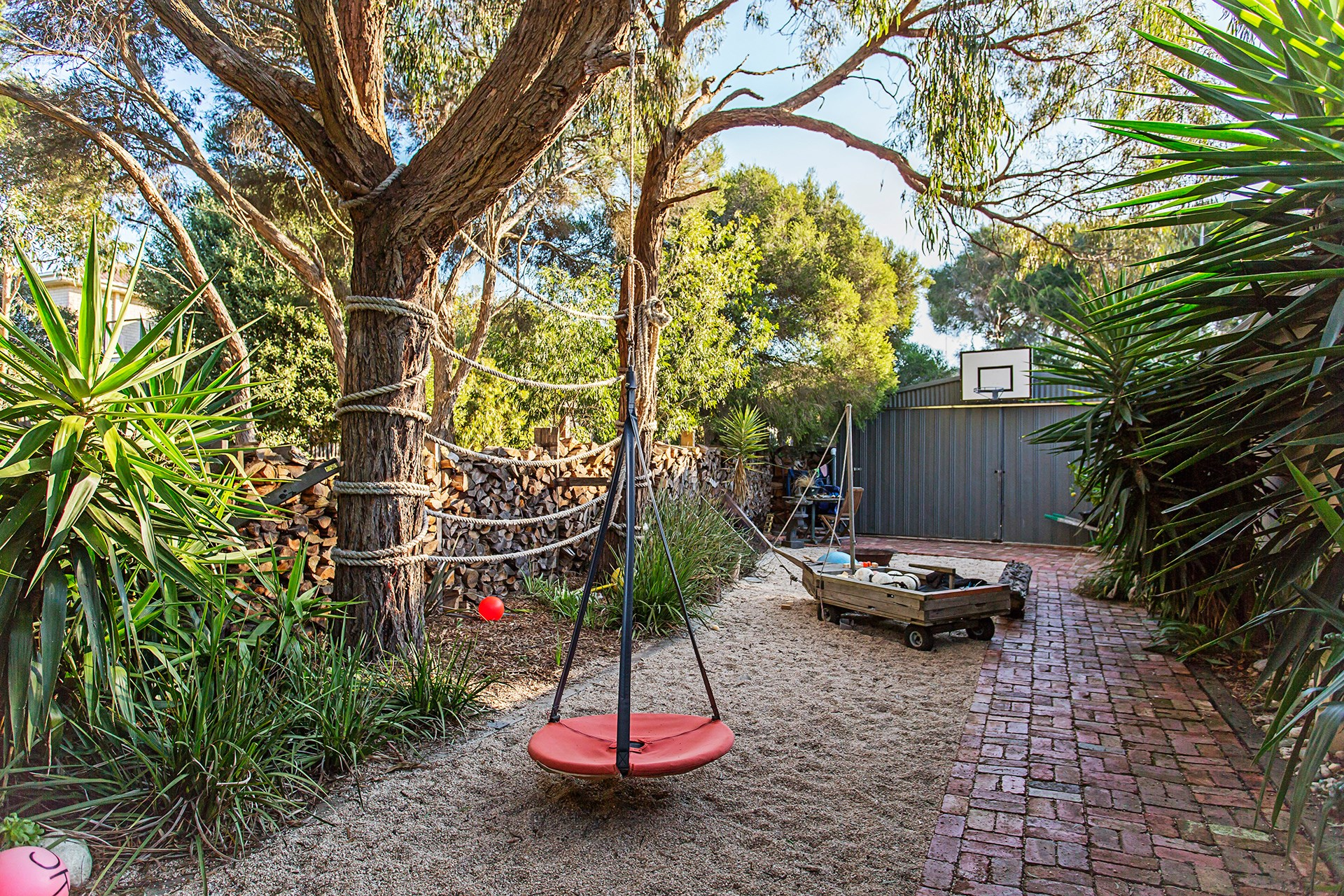 """**Lawn is not a necessity** – even if you have kids. Decking, paving, gravel and sand are all viable alternatives that will save you from mowing. [Take a tour of this kid-friendly homemade garden](http://www.homestolove.com.au/gallery-how-to-create-a-homemade-garden-2279