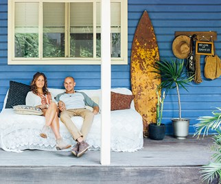 Couple on a weatherboard verandah on NSW's North Coast